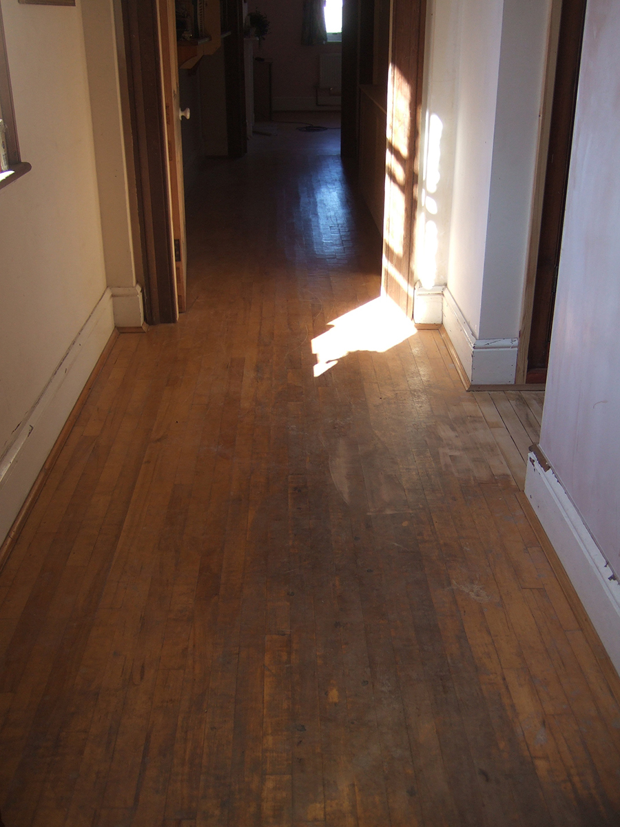 Beech strip wood floor worn and dirty