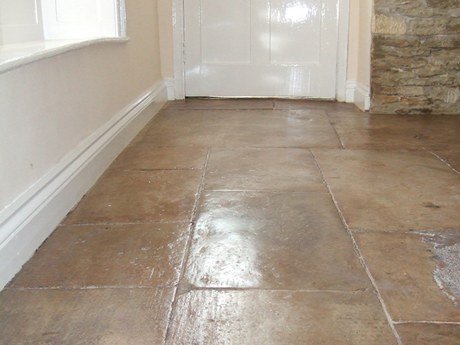 Old Cotswold flagstone floor cleaned grouted and polished