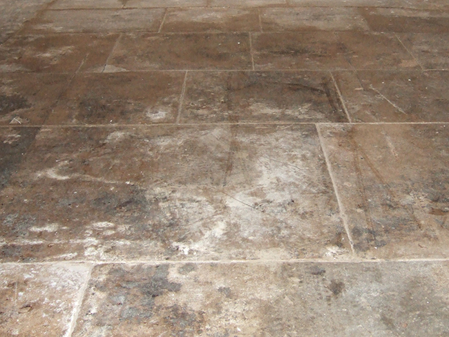 Flagstones bitumen stained