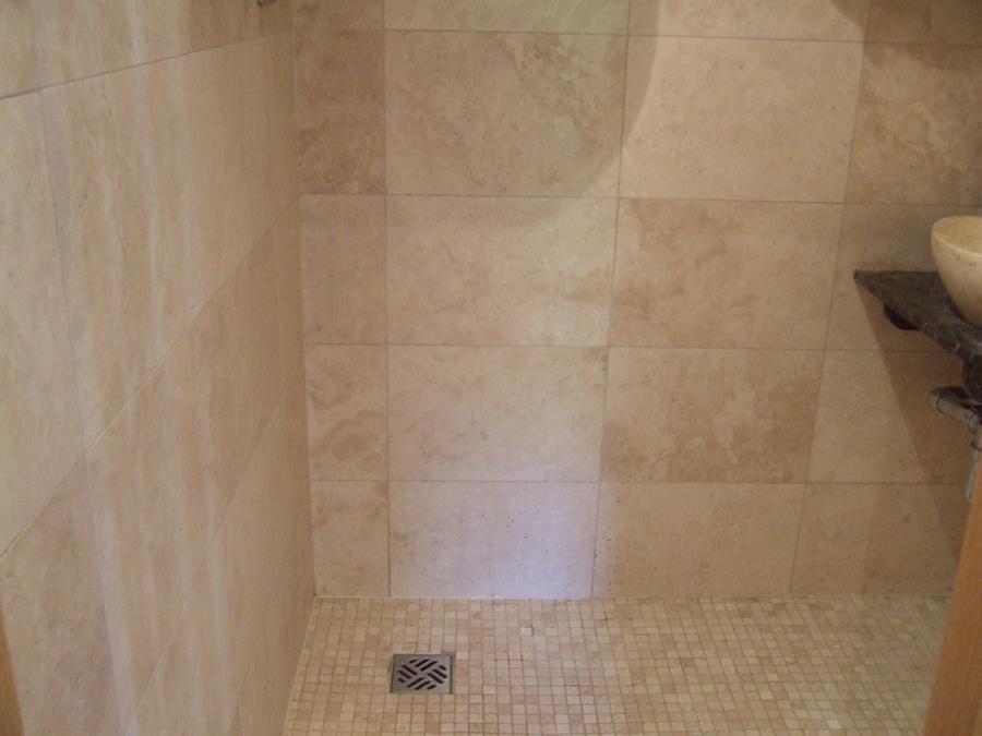 Travertine tiles restored after a fire