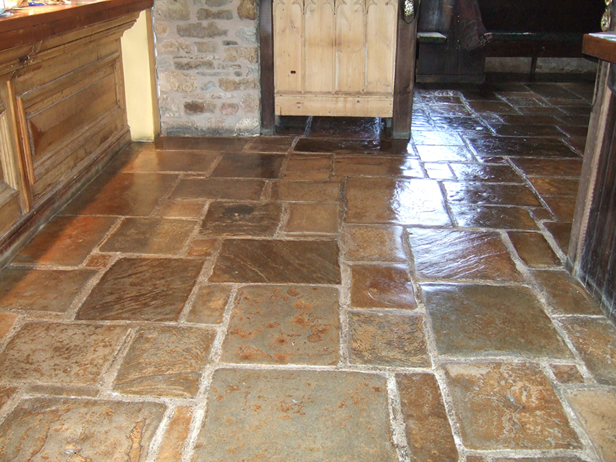 Restored flood damaged flagstone floor