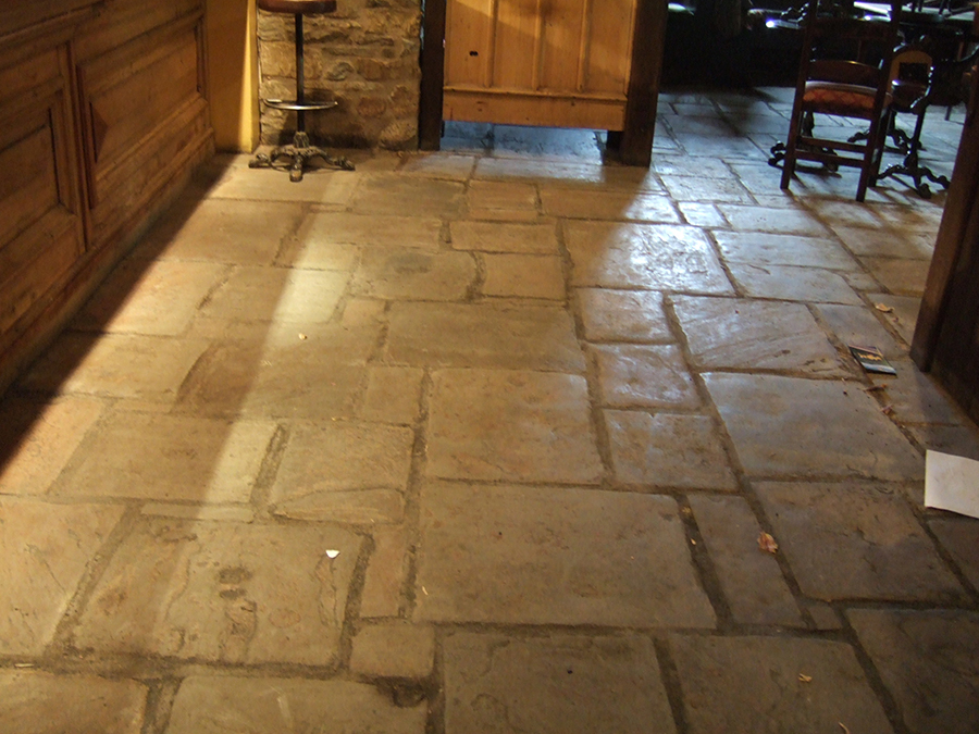 Flood damaged flagstone floor in a restaurant in oxford shire