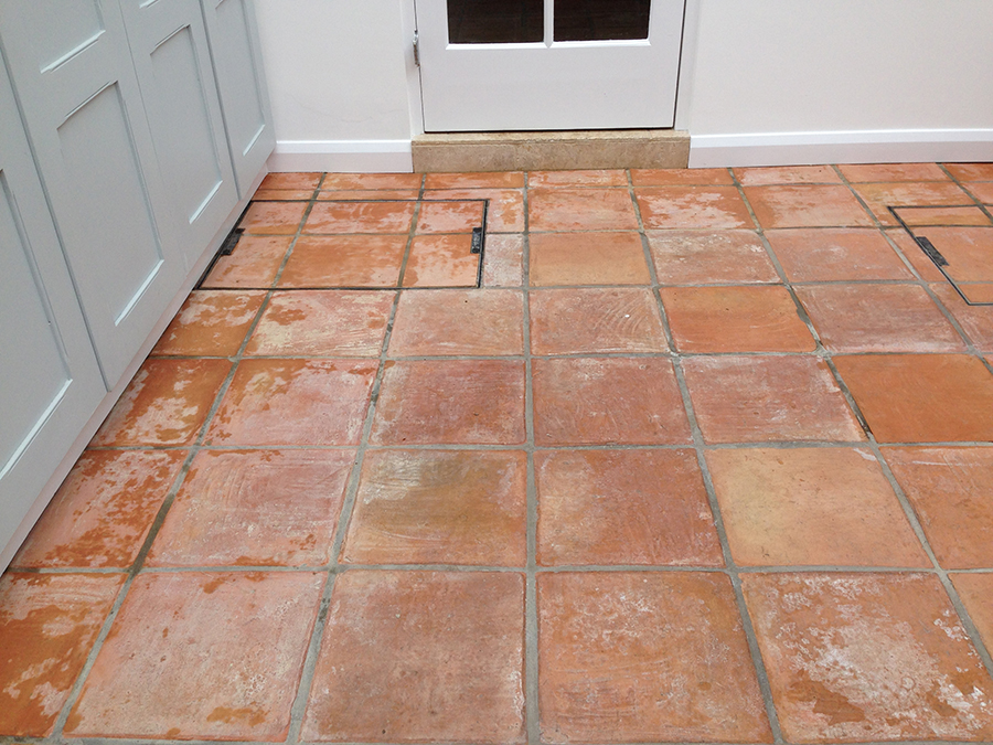 Flood damaged terracotta tiles in Exeter