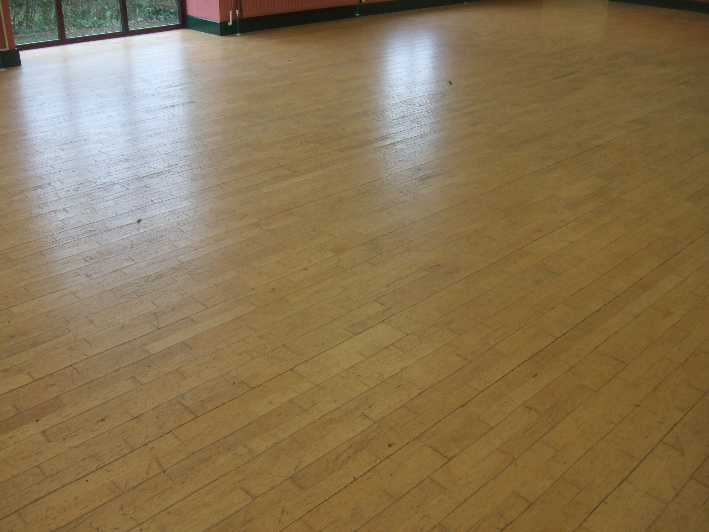 Community hall with damaged beech laminate flooring