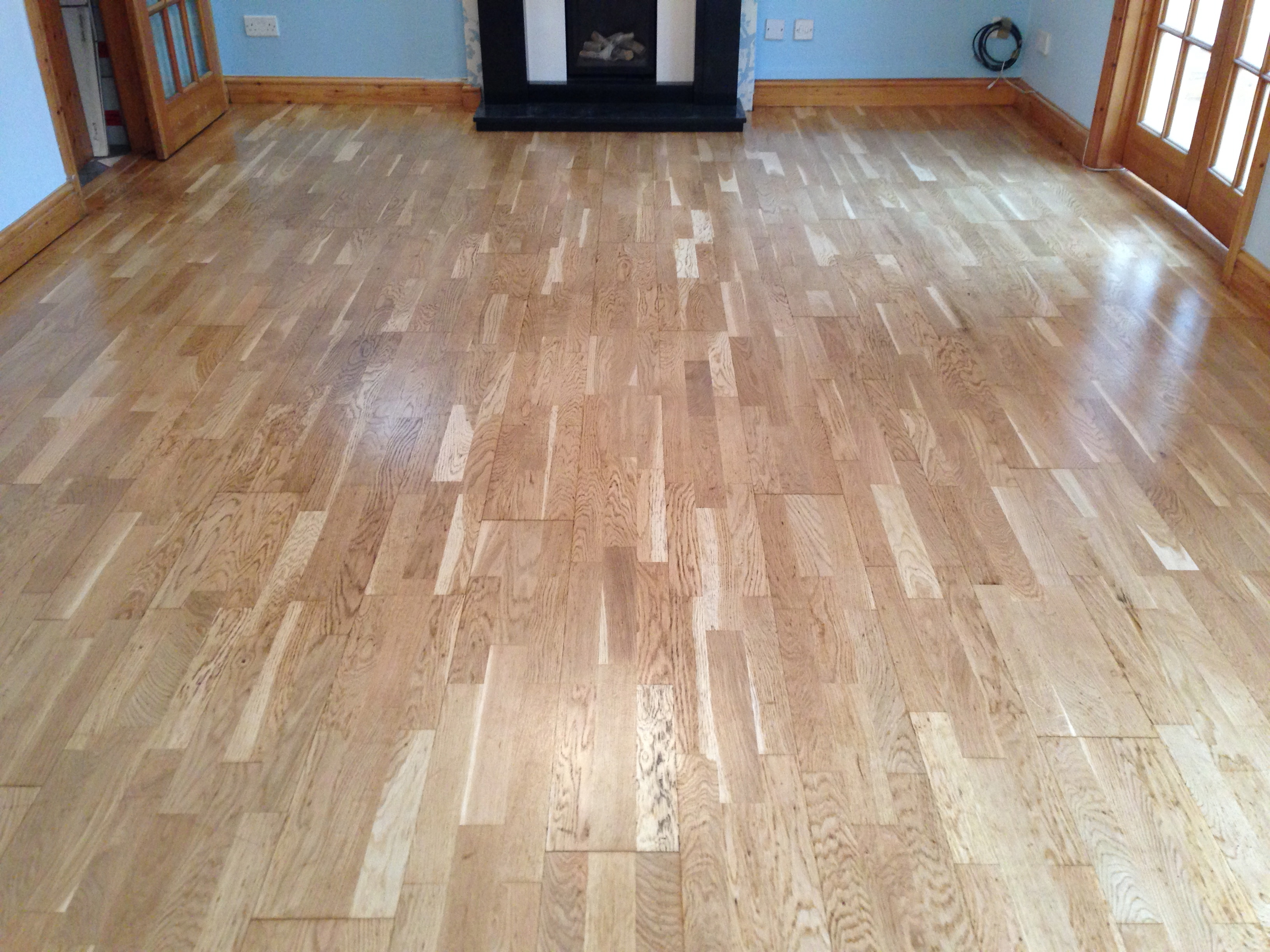 laminated wood floor repaired sanded and varnished
