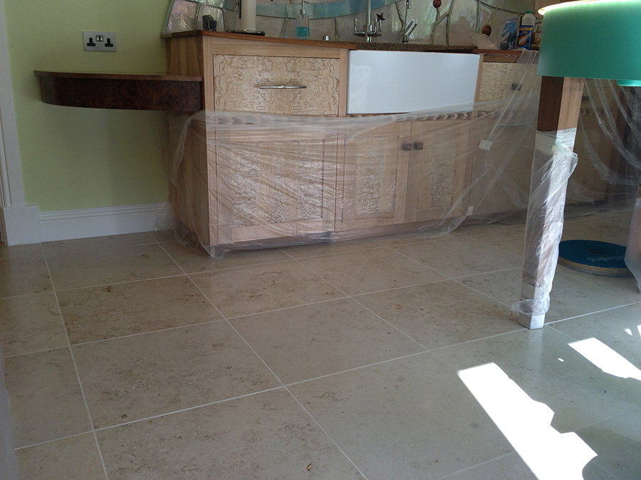 Limestone floor stained with grout