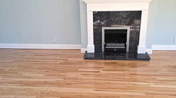 Beech floor in a living room with fireplace