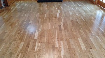 A sanded and lacquered laminate floor in a dining room