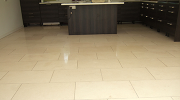 Limestone floor tiles in a kitchen polished.