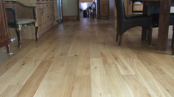Oak floorboards in a kitchen after sanding and sealing
