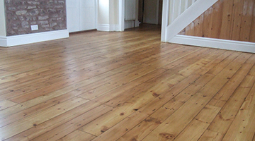 Pine floor in a hallway sanded and varnished