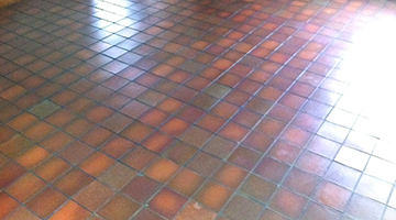 Quarry-tiled floor in a dining room cleaned and sealed