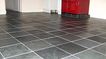 Slate floor tiles restored in a kitchen