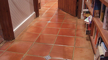 Terracotta floor tiles with stain proof seal in a hallway