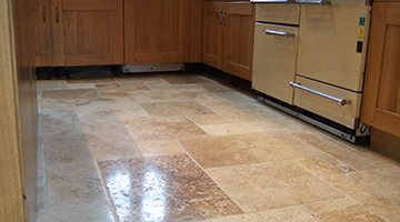 Travertine floor in kitchen polished.
