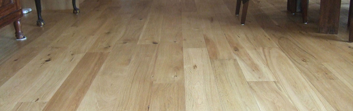 Oak floorboards in a kitchen sanded and lacquered
