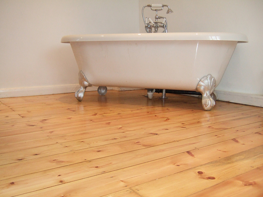Varnished pine floorboards in a bathroom
