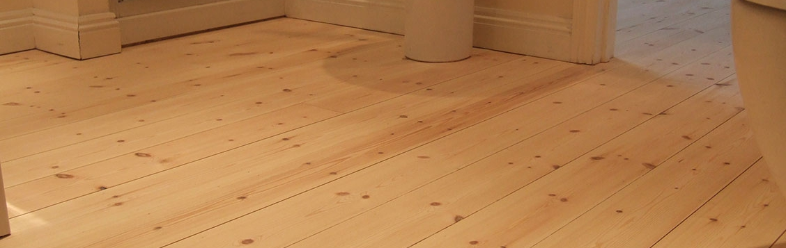 New pine floorboards stained