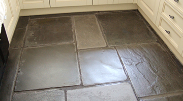 Example photo of an old restored flagstone floor