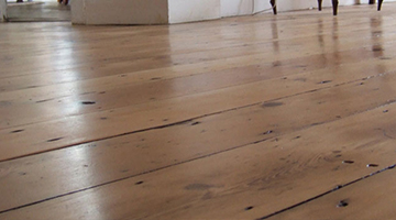 Victorian pine floor in a kitchen sanded and lacquered.