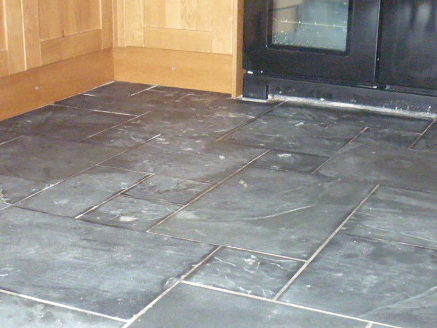 Grouting slate floor tiles