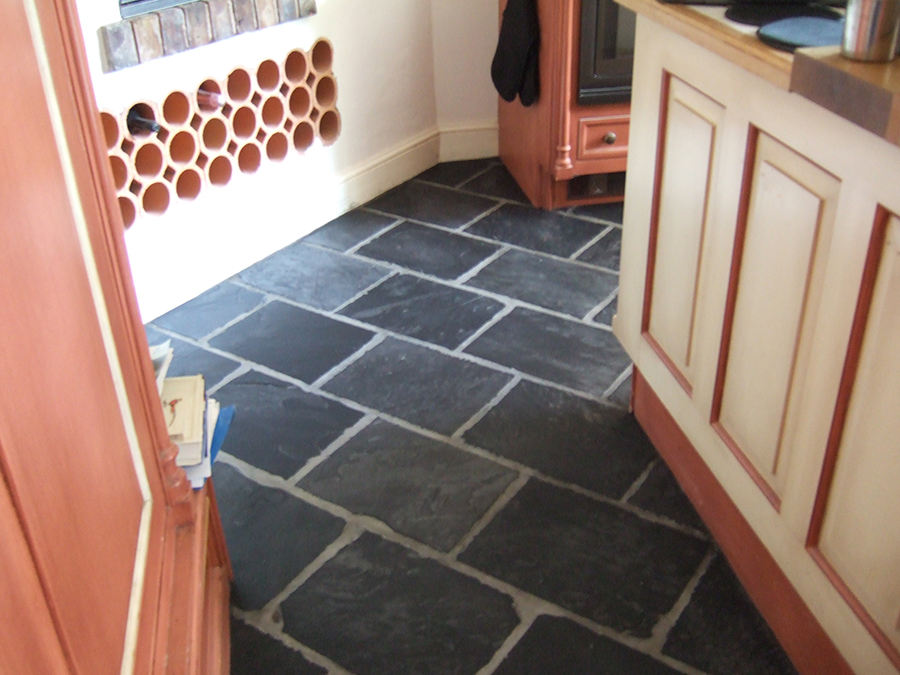 Slate floor tiles restored after flood