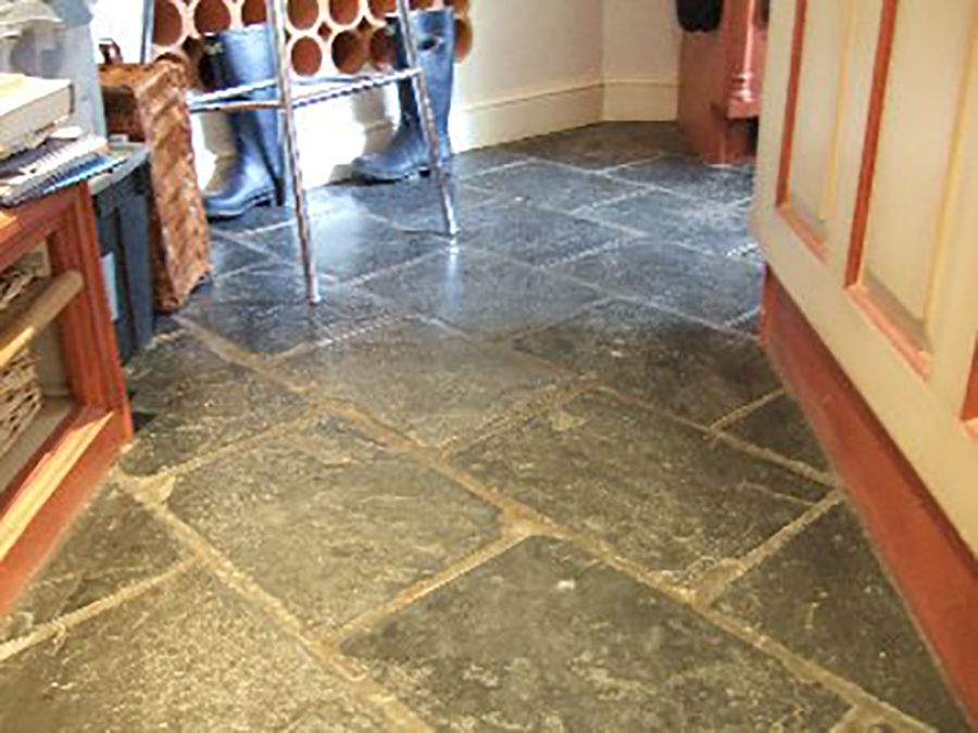 Flood damaged slate floor in Shrewsbury