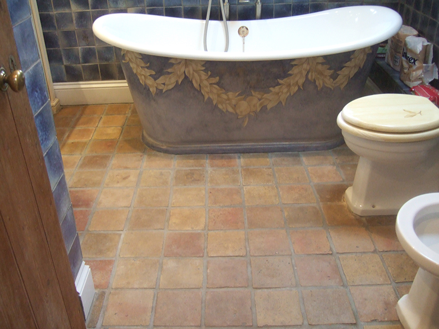 Terracotta tiles in bathroom water marking