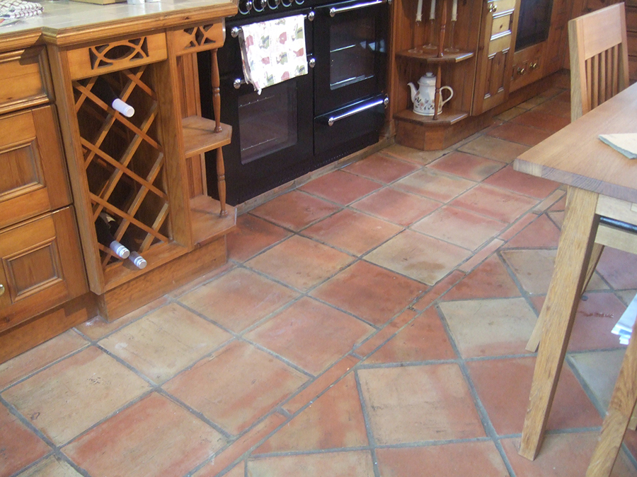 Terracotta floor with grease stains