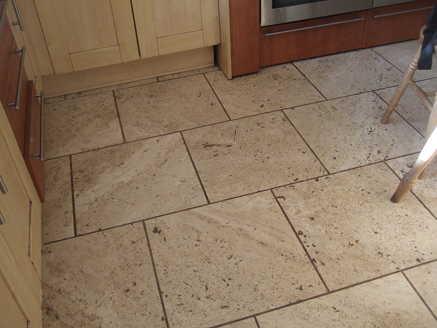Stained and pitted travertine floor