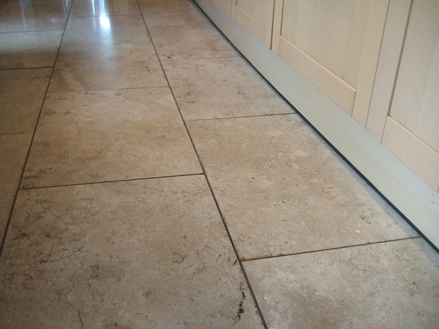 Soiled travertine tiles