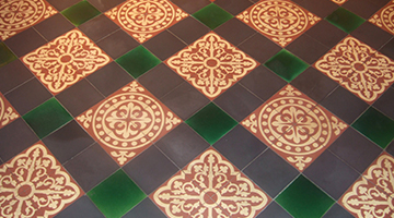 Example photo of a restored geometric Victorian quarry floor tiles.