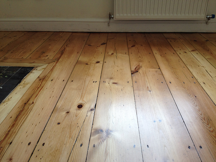 Sanding errors removed from old wood floor