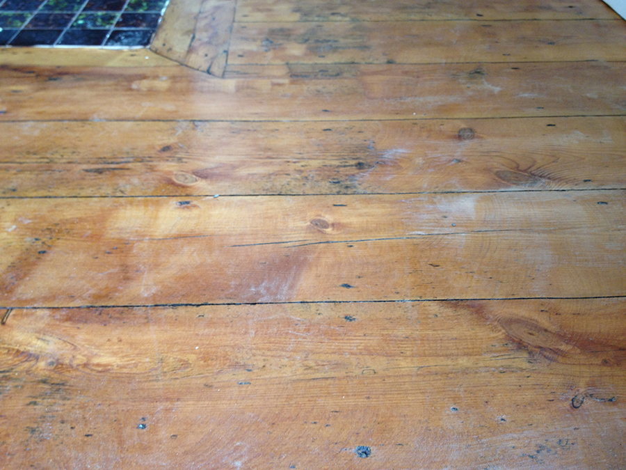 Pine wood floor scratched and damaged
