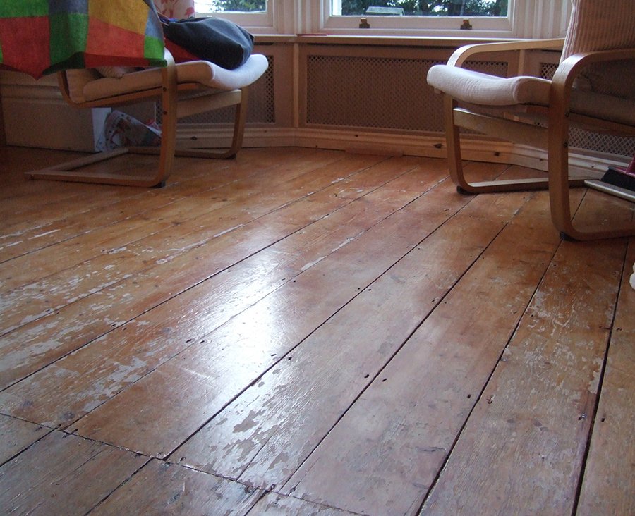 Pine floor boards before sanding